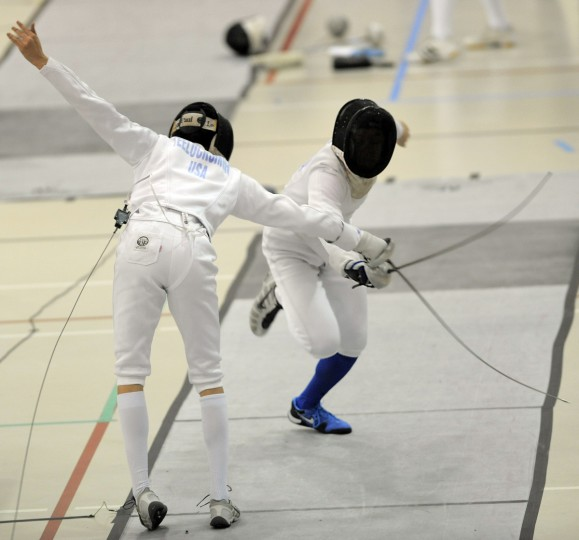 Left to right, Victor Teelucksingh, Towson, DC Fencers Club, and Jefferson Baker, Arlington, VA, Arlington Fencers' Club face each other during a seeding round of the division I-A men's epee event in the Regional Open Circuit (ROC) Charm City Classic at UMBC. (Kim Hairston/Baltimore Sun)