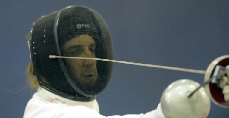 Robert Conway, Rosedale, Maryland Fencing Club, can be seen through the mesh of his mask as he competes in the division I-A men's epee event. (Kim Hairston/Baltimore Sun)