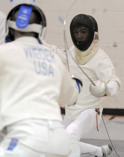 Ben Wieder, left, Philadelphia, Medeo Fencing Club, and Tiger Gao, Manhasset, NY, North Shore Fencers Club, meet in a men's epee seeding round at the Regional Open Circuit (ROC) Charm City Classic at UMBC. Seventy-one fencers took part in the division I-A men's epee event. (Kim Hairston/Baltimore Sun)