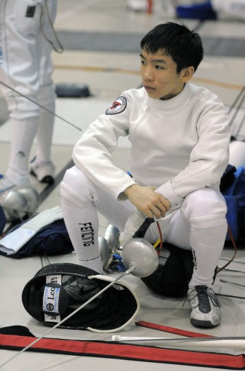 Tiger Gao, Manhasset, NY, North Shore Fencers Club, watches the action at the ROC is a qualifier for the Fencing National Championships. (Kim Hairston/Baltimore Sun)