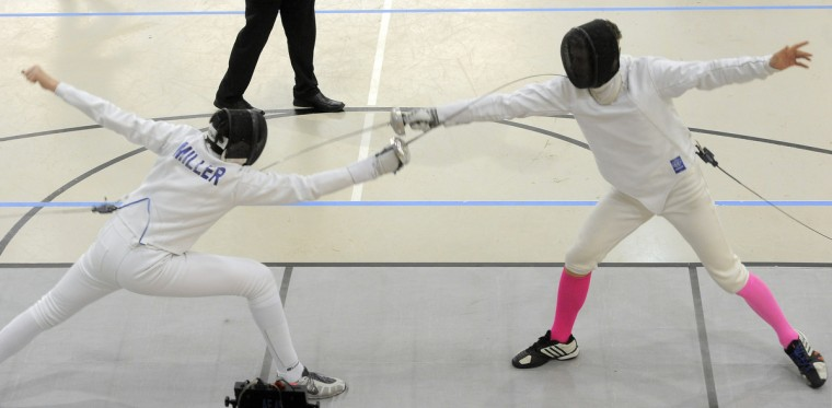 Left to right, Malcolm Miller, New York, Fencers Club, and Nathan Bailey, College Park, DC Fencers Club, are among the 71 fencers participating in the division I-A men's epee event. (Kim Hairston/Baltimore Sun)