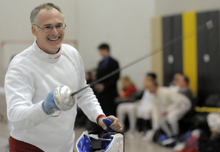 Joe Duecher, Severna Park, DC Fencers Club and Tournament Fencer's Club, smiles as he salutes his opponent after a bout. He is one of seventy-one fencers took part in the division I-A men's epee event in the Regional Open Circuit (ROC) Charm City Classic at UMBC. (Kim Hairston/Baltimore Sun)