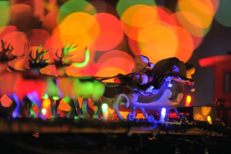 Santa and his reindeer rest on a flatbed car of a locomotive. (Karl Merton Ferron/Baltimore Sun Staff)