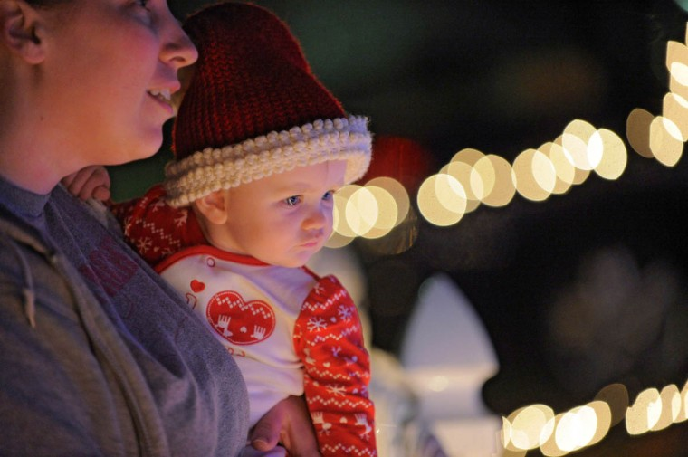 Millie Nieman, 8 months old, looks at the village scene of Beaverton while held by her mother Sarah Nieman. They live nearby. (Karl Merton Ferron/Baltimore Sun Staff)