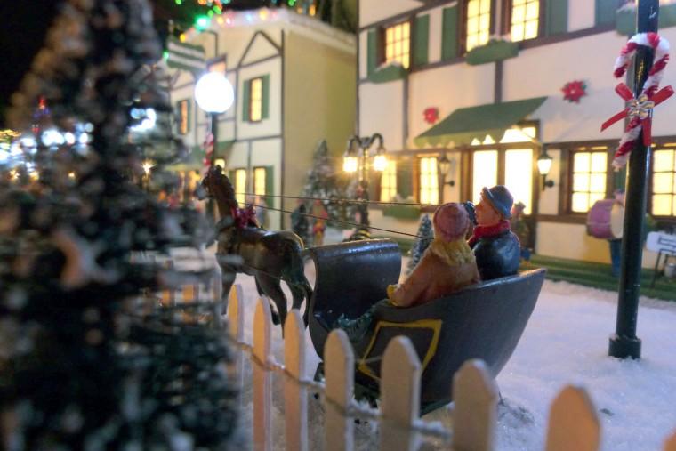 A couple ride in a horse-drawn sleigh. (Karl Merton Ferron/Baltimore Sun Staff)