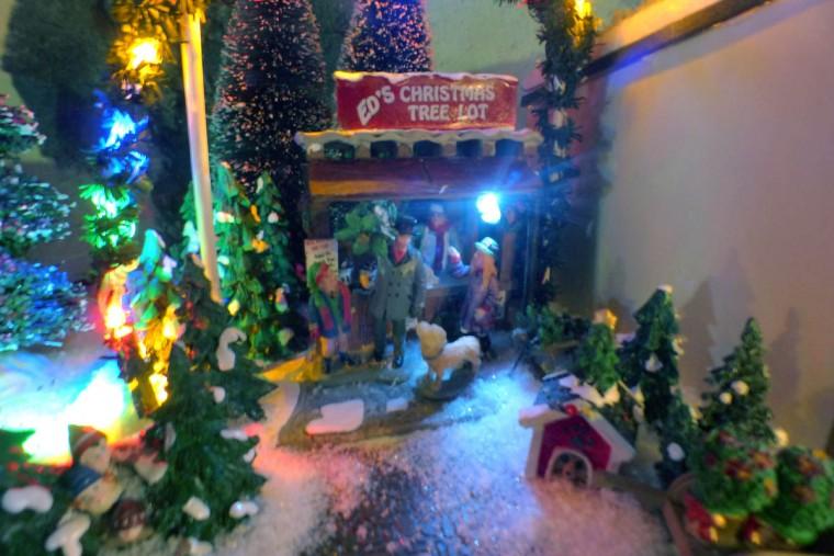Buying Christmas trees at the holiday resort of Beaverton Cliffs, a holiday G-gauge train village. (Karl Merton Ferron/Baltimore Sun Staff)