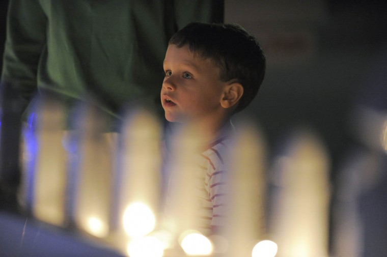 Max Lemke, 4 of Odenton gazes at the trains rolling by as he stands next to his mother Rebekah Lemke. (Karl Merton Ferron/Baltimore Sun Staff)