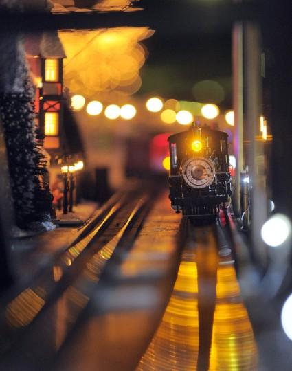 A steam engine train chugs through the night at Beaverton, a holiday N-gauge train village. (Karl Merton Ferron/Baltimore Sun Staff)