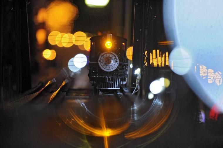 A steam engine train chugs through the night. (Karl Merton Ferron/Baltimore Sun Staff)
