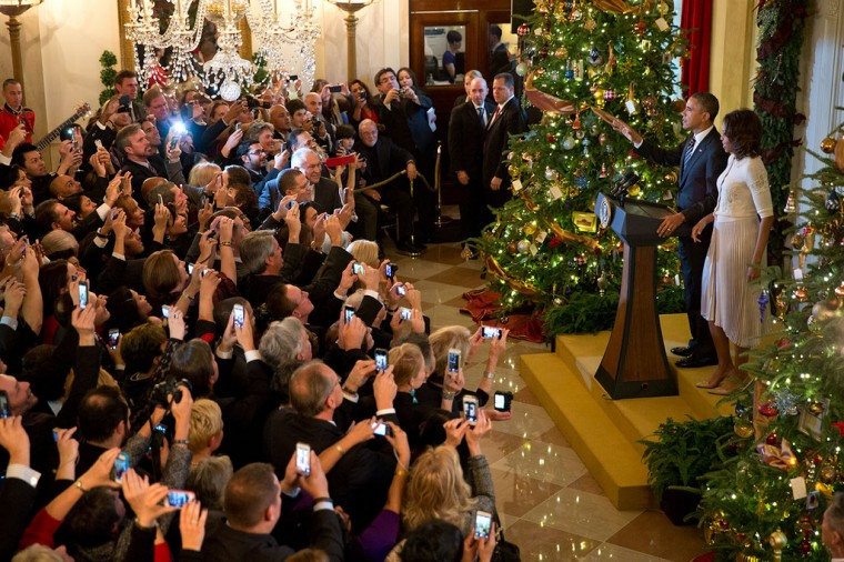 "Dec. 13, 2013 Everyone has a smart phone. The President delivers remarks with the First Lady during a Christmas reception in the Grand Foyer of the White House."" (Official White House Photo by Pete Souza)"