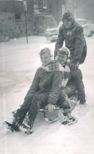 Mary Riley, Deborah Butcher and Patrick Reed try sledding in the 2800 block of Barclay Street in December 1960. (Walter McCardell/Baltimore Sun file)