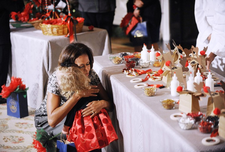 First lady Michelle Obama welcomes military families to a tour of holiday decorations at the White House on Wednesday, Dec. 4, 2013, in Washington, DC. (Olivier Douliery/Abaca Press/MCT)