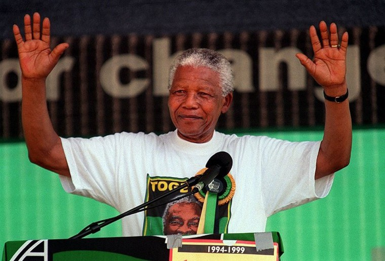 South African President Nelson Mandela waves to the crowd at the end of his speech during a rally at Brits, South Africa in this April 11, 1999, file photo. (Anacleto Rapping/Los Angeles Times/MCT)