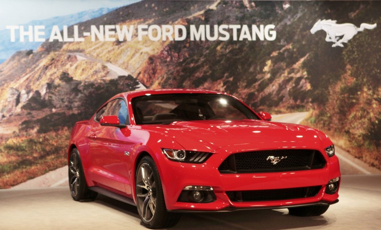 Ford Motor Co. unveils its all new 2015 Ford Mustang in Dearborn, Michigan December 5, 2013. (Rebecca Cook/Reuters photo)