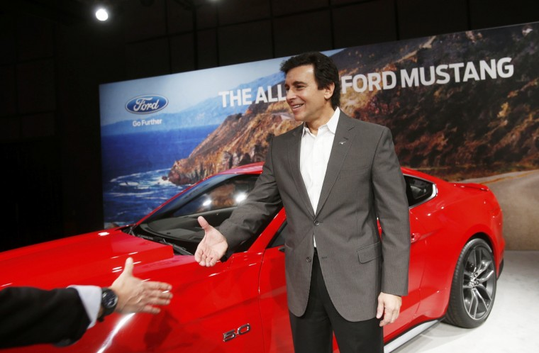 Ford Motor Co. Chief Operating Officer Mark Fields reaches out to shake hands during an unveiling of its all new 2015 Ford Mustang in Dearborn, Michigan December 5, 2013. (Rebecca Cook/Reuters photo)