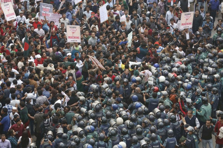Police try to stop a rally as protesters try to surround and block access to the High Commission of Pakistan in Dhaka. Police used batons as hundreds of protesters try to surround and block access to the high commission, in protest of a resolution adopted by the National Assembly of Pakistan. The statement by the National Assembly of Pakistan expressed concern over the execution of Jamaat-e-Islami leader Abdul Quader Mollah on December 12, 2013, the first war crimes execution in Bangladesh. Bangladesh has summoned Pakistan's High Commissioner in Dhaka for a meeting to discuss the resolution, local media reported. (Andrew Biraj/Reuters)