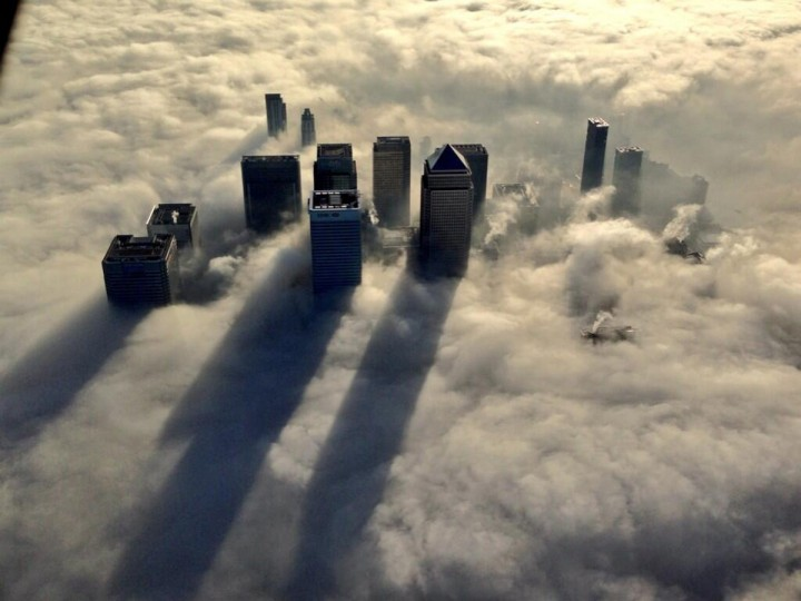 The Canary Wharf business district of east London taken from the Metropolitan Police helicopter is seen during a foggy morning in this photograph received via the Metropolitan Police in London. (Reuters)