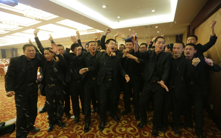 Students at Tianjiao Special Guard/Security Consultant sing during a group dinner on the outskirts of Beijing December 14, 2013. Former Chinese soldier Chen Yongqing has big ambitions for his bodyguard training school Tianjiao, which he says is China's first professional academy to train former soldiers and others as personal security guards. Chen charges 500,000 yuan ($82,400) a year for each protector as China's rich and famous look to bolster their safety and sense of importance. (REUTERS/Jason Lee/December 14, 2013)