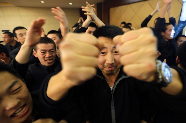 Chen Yongqing, the owner of Tianjiao Special Guard/Security Consultant gestures during a group dinner with his students on the outskirts of Beijing December 14, 2013. Former Chinese soldier Chen has big ambitions for his bodyguard training school Tianjiao, which he says is China's first professional academy to train former soldiers and others as personal security guards. Chen charges 500,000 yuan ($82,400) a year for each protector as China's rich and famous look to bolster their safety and sense of importance. (REUTERS/Jason Lee/December 14, 2013)