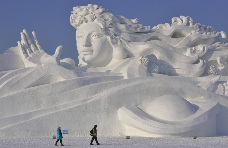 Visitors walk past a giant snow sculpture ahead of the 30th Harbin Ice and Snow Festival in Harbin, Heilongjiang province December 28, 2013. The festival kicks off on January 5, 2014. (REUTERS/Sheng Li)
