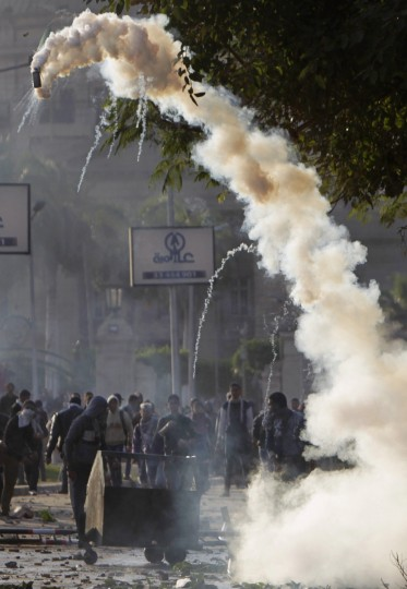 A tear gas canister flies towards Cairo University students, who are supporters of the Muslim Brotherhood and ousted Egyptian President Mohamed Mursi, during a clash with Egyptian security forces in front of the main gate of the university, in Cairo December 10, 2013. (Mohamed Abd El Ghany/Reuters)