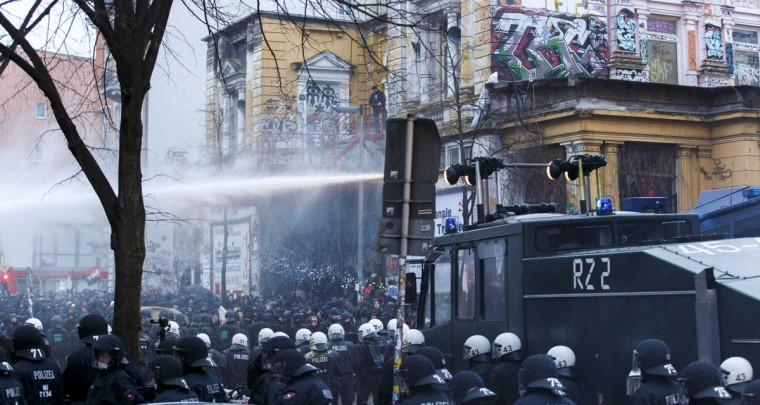 German police use water cannons to clear a street following clashes in front of the 'Rote Flora' cultural centre during a demonstration in Hamburg, December 21, 2013. Pro 'Rote Flora' demonstrators protested to protect the cultural centre from being closed. (REUTERS/Morris Mac Matzen)