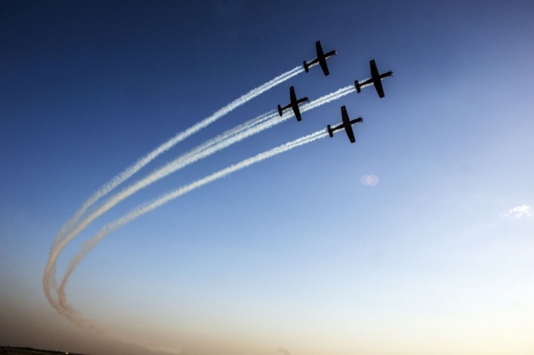 T-6 Texan II planes fly in formation during an air force pilots' graduation ceremony at Hatzerim air base in southern Israel December 26, 2013. (REUTERS/Nir Elias)
