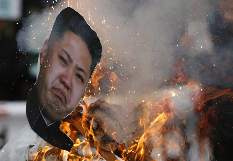 An effigy of North Korean leader Kim Jong Un is set on fire during an anti-North Korean rally on the second anniversary of the death of former leader Kim Jong Il in central Seoul December 17, 2013. North Korea's political and military elite publicly pledged their loyalty to leader Kim Jong Un on Tuesday, less than a week after he ordered the execution of a powerful family ally in a rare public purge. Kim Hong-Ji/Reuters