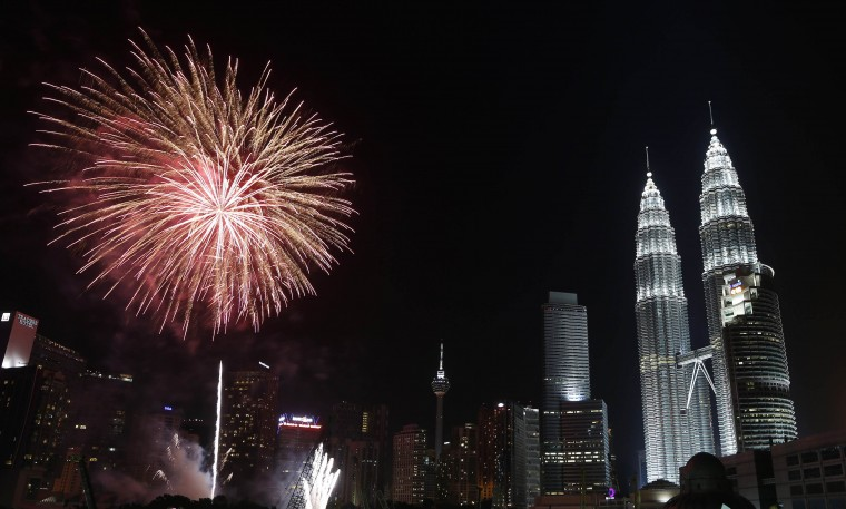 Fireworks explode near Malaysia's landmark Petronas Twin Towers during New Year celebrations in Kuala Lumpur January 1, 2014. (REUTERS/Samsul Said)
