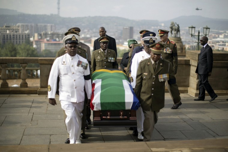 Military personnel carry the remains of the late Nelson Mandela at the Union Buildings in Pretoria where it will lie in state for three days. (Marco Longari/Reuters)