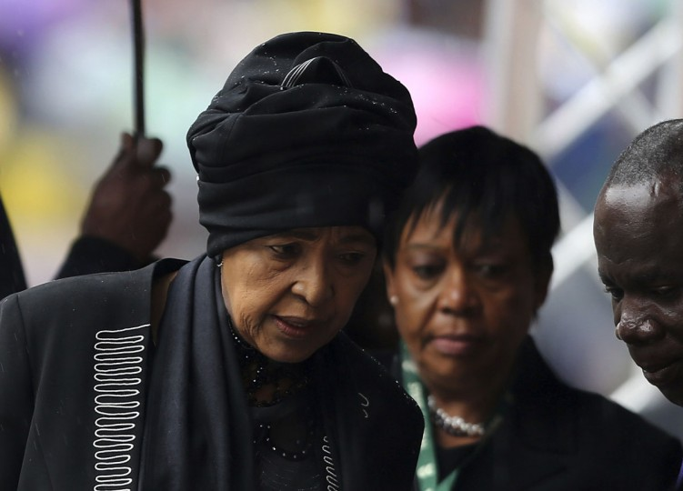 Former South African President Nelson Mandela's ex-wife Winnie Mandela (left) arrives at the First National Bank Stadium ahead of the national memorial service for Nelson Mandela in Johannesburg December 10, 2013. World leaders from U.S. President Barack Obama to Cuba's Raul Castro joined thousands of South Africans to honor Nelson Mandela on Tuesday in a memorial that will celebrate his gift for uniting enemies across political and racial divides. (Siphiwe Sibeko/Reuters)