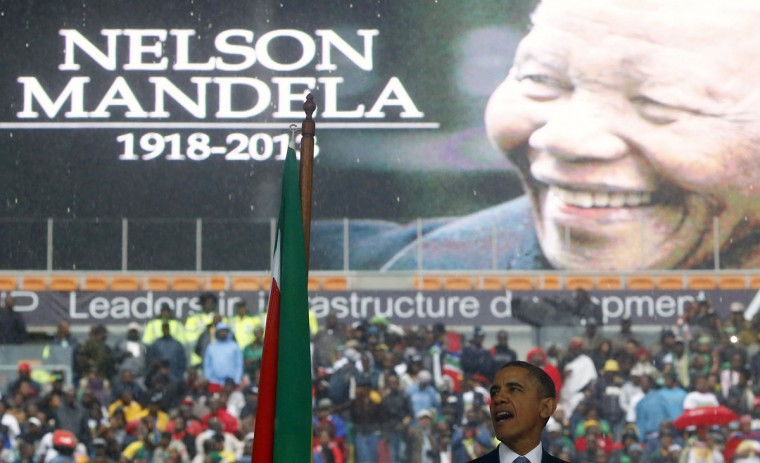 "U.S. President Barack Obama delivers his speech during the memorial service for late South African President Nelson Mandela at the First National Bank stadium, also known as Soccer City, in Johannesburg December 10, 2013. Obama hailed Nelson Mandela as a ""giant of justice"" on Tuesday but said too many leaders in the world claimed solidarity with his struggle for freedom ""but do not tolerate dissent from their own people"". (Kai Pfaffenbach/Reuters)"