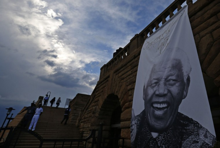 A giant picture of former South African President Nelson Mandela is pictured at the entrance of the Union Buildings in Pretoria December 12, 2013. (REUTERS/Yves Herman)