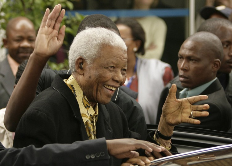 Former South African President Nelson Mandela waves as he leaves after casting his vote at a polling station in Houghton, Johannesburg, in this April 22, 2009 file photo. Mandela has passed away on December 5, 2013 at the age of 95. (Siphiwe Sibeko/Files/REUTERS)