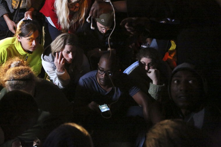 People listen to a radio as South African President Jacob Zuma announces the death of former South African President Nelson Mandela in Houghton, December 5, 2013. Mandela died peacefully at his Johannesburg home on Thursday after a prolonged lung infection, Zuma said. Mandela, the country's first black president and anti-apartheid icon known in South Africa by his clan name of Madiba, emerged from 27 years in apartheid prisons to help guide South Africa through bloodshed and turmoil to democracy. (Siphiwe Sibeko/REUTERS)