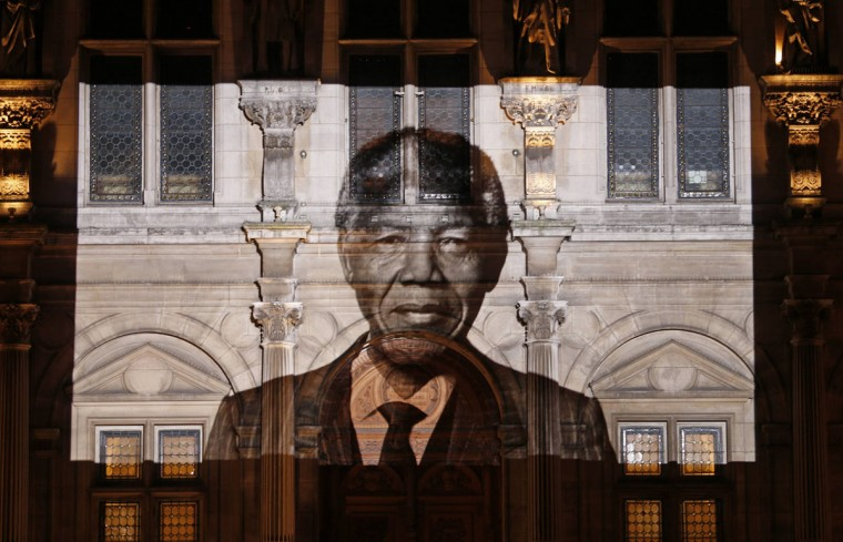 An image of late South African President Nelson Mandela is projected on the facade of Paris town hall, December 6, 2013. South African anti-apartheid hero Mandela died peacefully at home in Johannesburg at the age of 95 on Thursday after months fighting a lung infection, leaving his nation and the world in mourning for a man revered as a moral giant. (REUTERS/Charles Platiau)