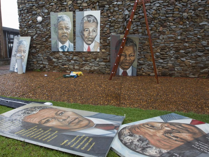 Portraits of former South African President Nelson Mandela are left out in the open after workers took shelter from the rain while hanging them at the Nelson Mandela Museum in Qunu, December 10, 2013. World leaders, from U.S. President Barack Obama to Cuba's Raul Castro, will pay homage to Mandela at the memorial that will recall his gift for bringing enemies together across political and racial divides. (Rogan Ward/Reuters)