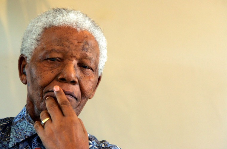 "Former South African President Nelson Mandela attends a memorial for his biographer and former editor of ""Drum"" magazine Anthony Sampson in Johannesburg in this February 8, 2005 file photo. Mandela has passed away on December 5, 2013 at the age of 95. (Radu Sigheti/REUTERS files)"