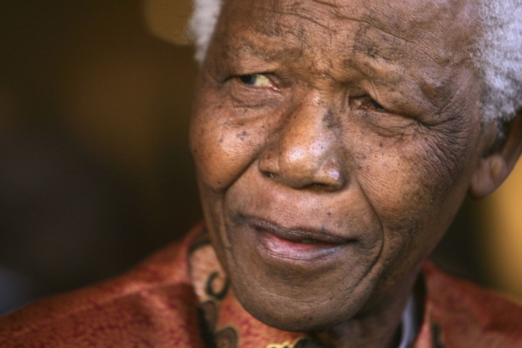 Former South African President Nelson Mandela smiles as he formally announces his retirement from public life at his foundation's offices in Johannesburg in this June 1, 2004 file photo. Mandela has passed away on December 5, 2013 at the age of 95. (Mike Hutchings/REUTERS files)