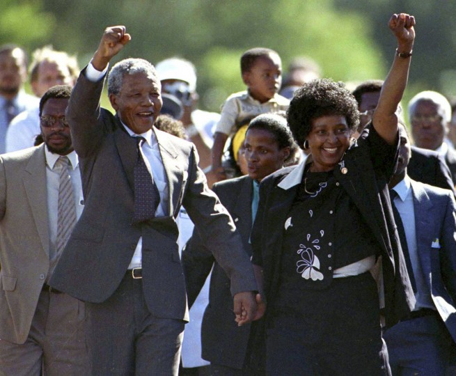 Nelson Mandela (front L), accompanied by his wife Winnie, walks out of the Victor Verster prison, near Cape Town, after spending 27 years in apartheid jails in this February 11, 1990 file photo. (Juda Ngwenya/REUTERS files)
