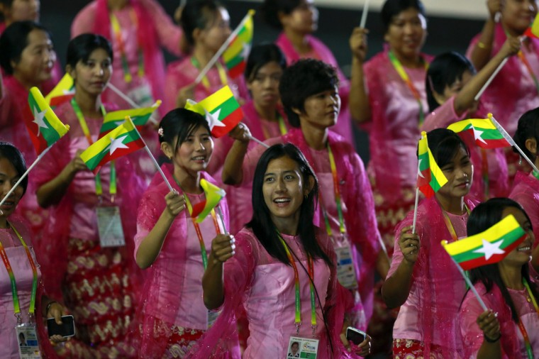 Myanmar's athletes take part in a parade during the opening ceremony of the 27th SEA Games in Naypyitaw December 11, 2013. Myanmar is hosting the games for the first time in over 40 years. (Soe Zeya Tun/Reuters)