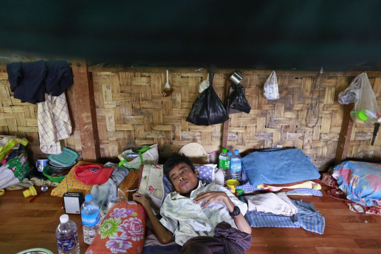 A man, who has HIV, lies on his bed at HIV/AIDS hospice, founded by a member of the National League for Democracy (NLD) party in suburbs of Yangon, Myanmar, December 1, 2013. (Soe Zeya Tun/Myanmar)
