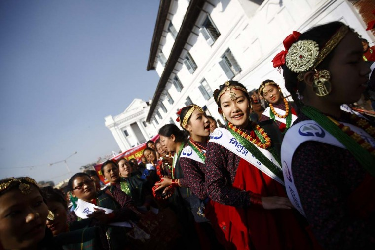 Gurung girls wearing traditional costumes sing and dance while taking part in a New Year parade in Kathmandu December 30, 2013. The Gurung community in Nepal celebrates their Tamu Lhosar or Losar (New Year) with a feast and various cultural programs to usher in the year of the horse. (Navesh Chitrakar/Reuters)