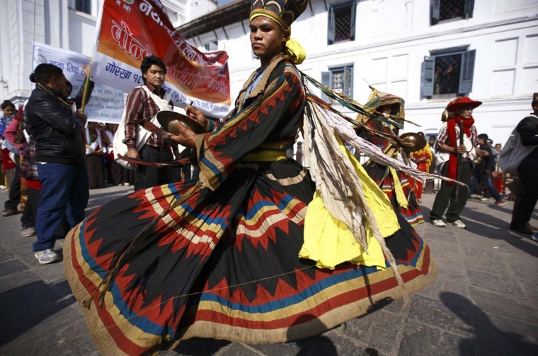 A Gurung man in a traditional costume performs during the New Year parade in Kathmandu December 30, 2013. The Gurung community in Nepal celebrates their Tamu Lhosar or Losar (New Year) with a feast and various cultural programs to usher in the year of the horse. (Navesh Chitrakar/Nepal Society)
