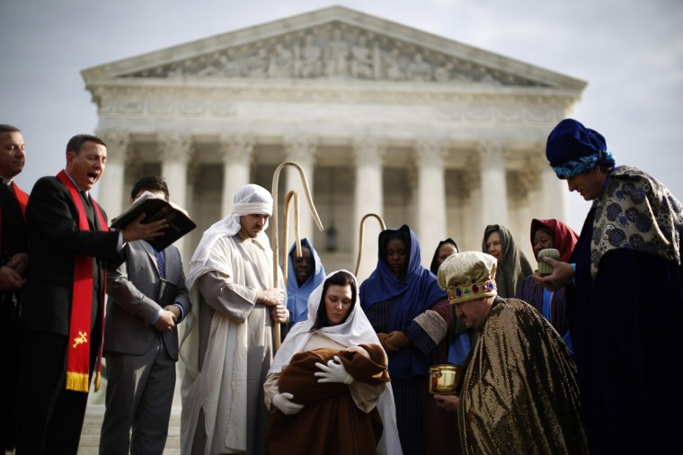 "Actors dressed for a nativity scene are pictured during a prayer reading in front of the Supreme Court in Washington December 3, 2013. The religious group ""Faith and Action"" held their annual ""Live Nativity on Capitol Hill"" on Tuesday to exercise their first amendment rights. (Jason Reed/Reuters)"