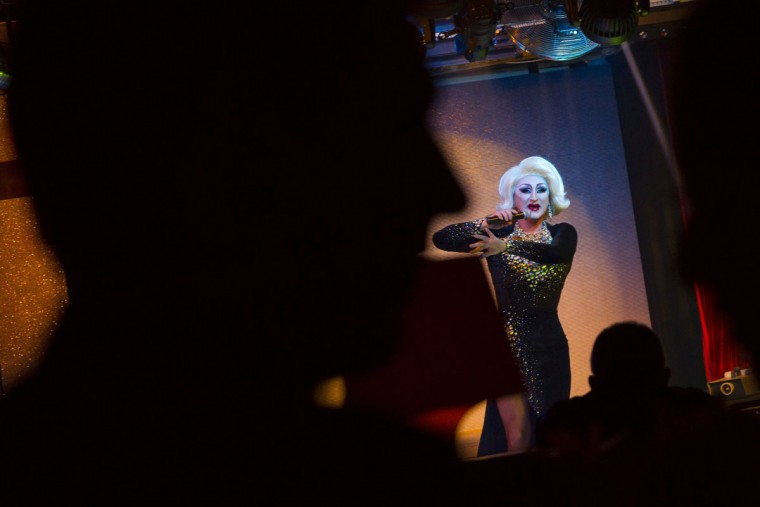 People watch as a drag queen takes part in a performance at Mayak, a gay cabaret club in Sochi, southwestern Russia, October 28, 2013. During Soviet times, Sochi gained a reputation for tolerance but the city's once vibrant gay scene has been shrinking since Russia won the right to host the 2014 Winter Olympics. (Thomas Peter/Reuters)