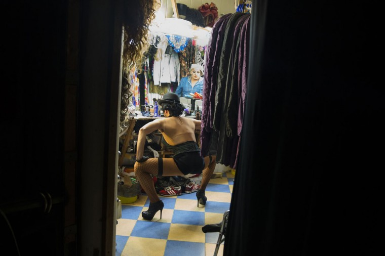 A performer prepares to take part in a drag show backstage at Mayak, a gay cabaret club in Sochi, Russia, October 28, 2013. During Soviet times, Sochi gained a reputation for tolerance but the city's once vibrant gay scene has been shrinking since Russia won the right to host the 2014 Winter Olympics. (Thomas Peter/Reuters)