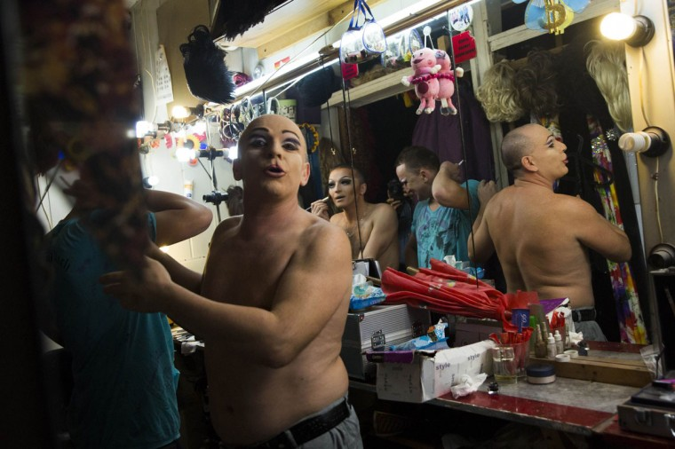 "Performers prepare to take part in a drag show backstage at Mayak, a gay cabaret club in Sochi, Russia October 28, 2013. In 2013, Russian President Vladimir Putin signed a law banning the spread of ""gay propaganda"" among minors.Some activists have called for a boycott of the 2014 Winter Olympics in Sochi in protest. (Thomas Peter/Reuters)"