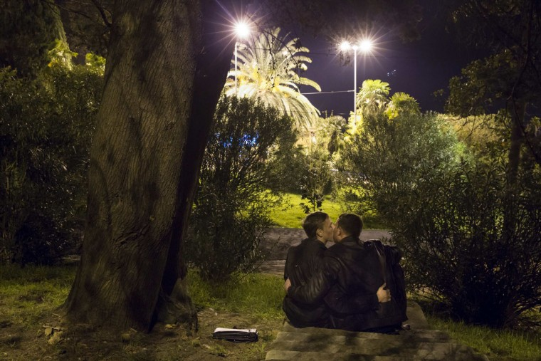 Gay rights activist Vladislav Slavsky (left) poses for a photograph with his boyfriend, who wants to remain anonymous, in a park near the Black Sea promenade in Sochi, southwestern Russia, October 21, 2013. During Soviet times, Sochi gained a reputation for tolerance. But the city's once vibrant gay scene has been shrinking since Russia won the right to host the 2014 Winter Olympics. (Thomas Peter/Reuters)