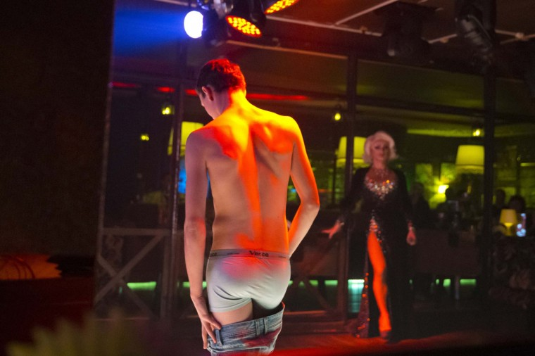 "A man strips during a drag performance at Mayak, a gay cabaret club in Sochi, Russia. Since Russian President Vladimir Putin signed a law banning the spread of ""gay propaganda"" among minors, anti-gay attitudes have become more prominent and violence against LGBT individuals is on the rise. (Thomas Peter/Reuters)"